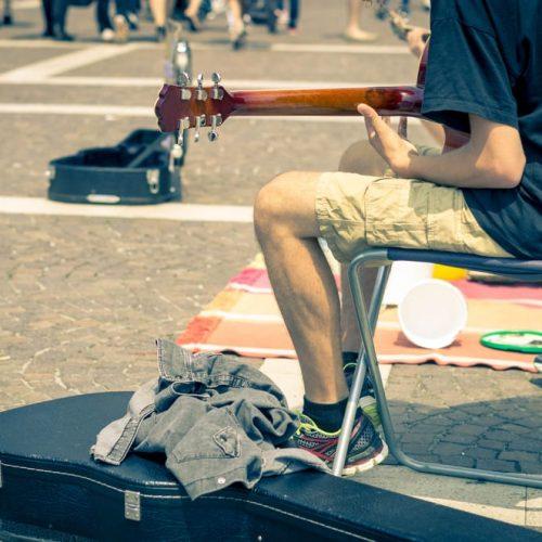 Street artist playing guitar