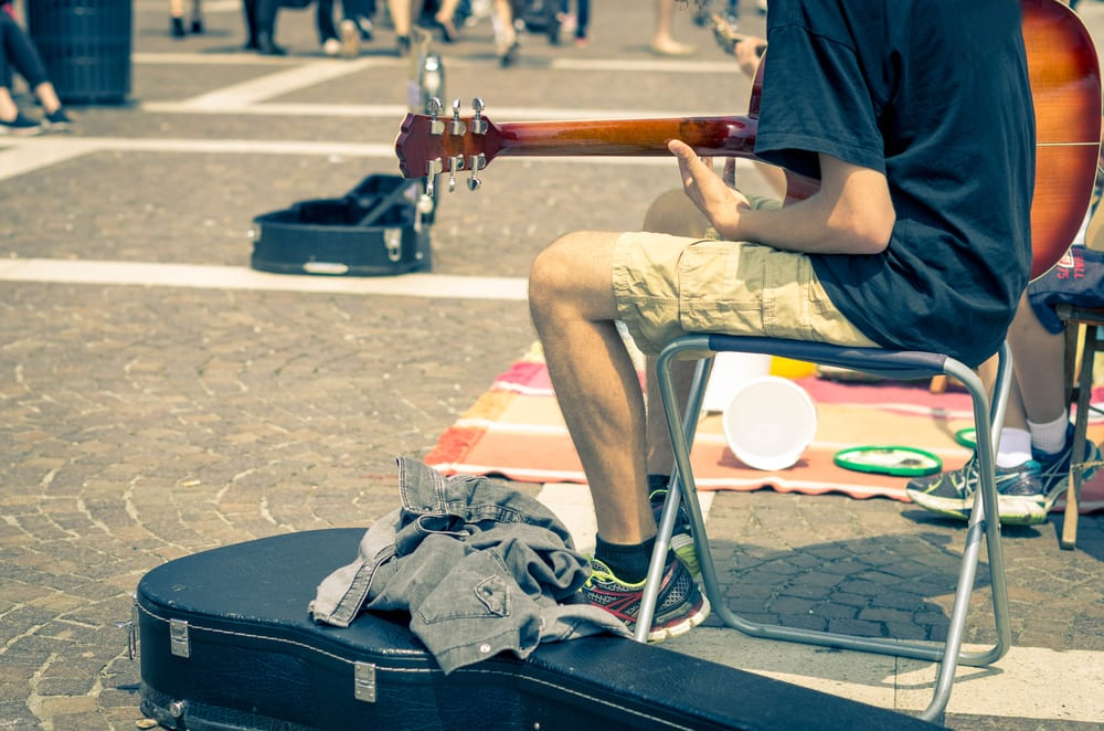 Street artist playing guitar